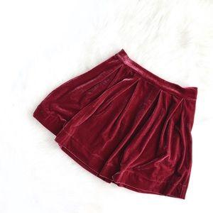 AKIRA | rose pink velvet pleated zip skater skirt